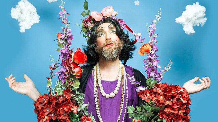 Drag bingo Vauxhall RVT drag queen in Jesus pose - wide
