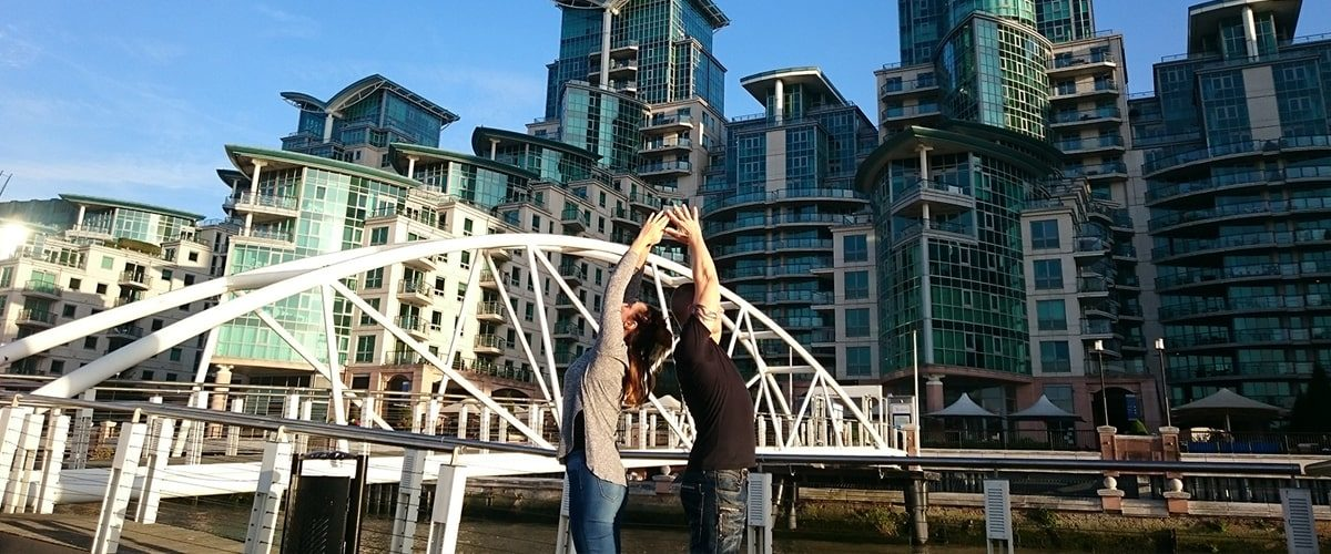 couple in a yoga pose near Vauxhall