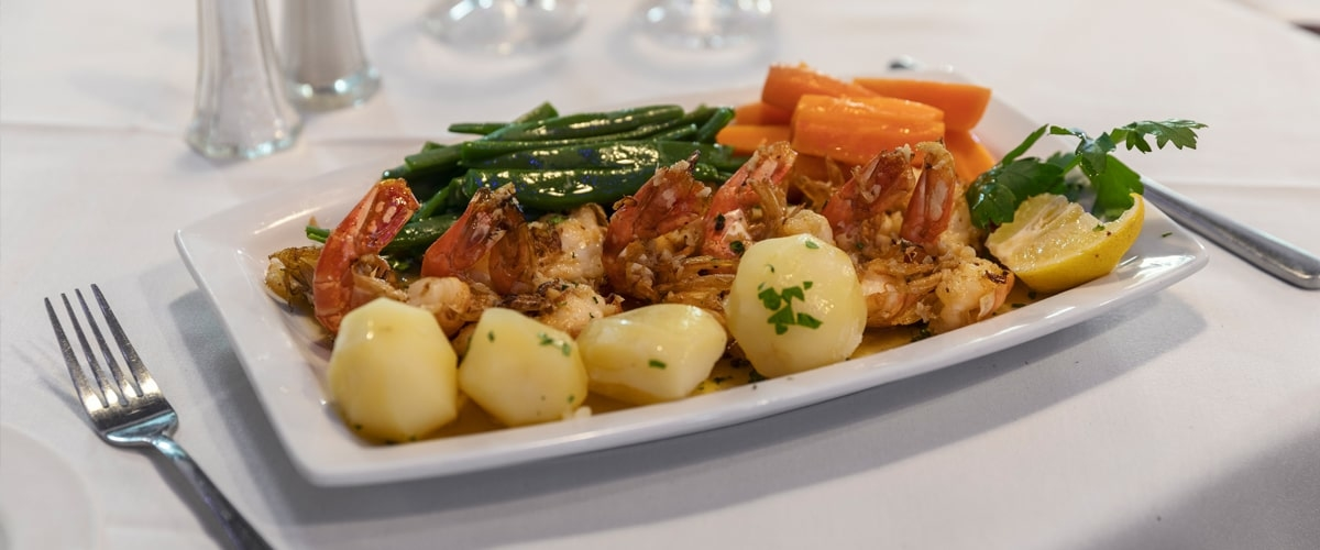 Potatoes and chicken with vegetables. Dish at Pico Bar