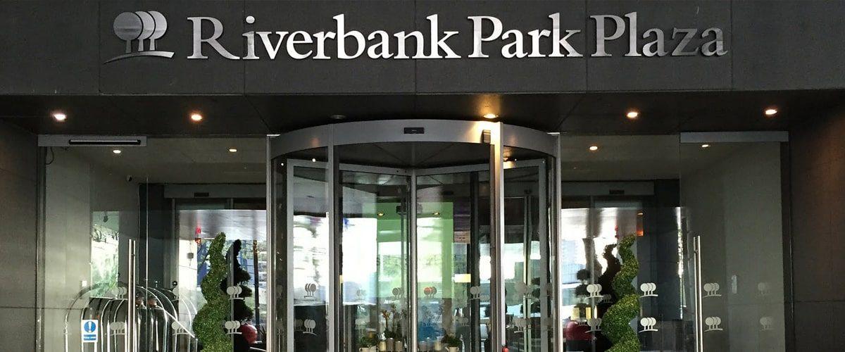 Riverbank Park plaza hotel logo signage