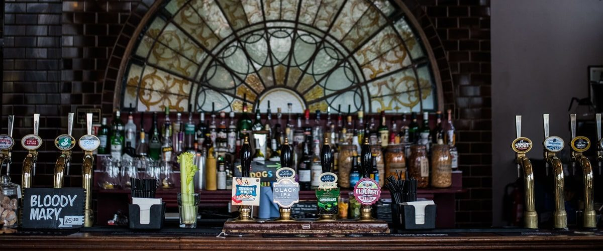The Black Dog pub bar with beers and spirits