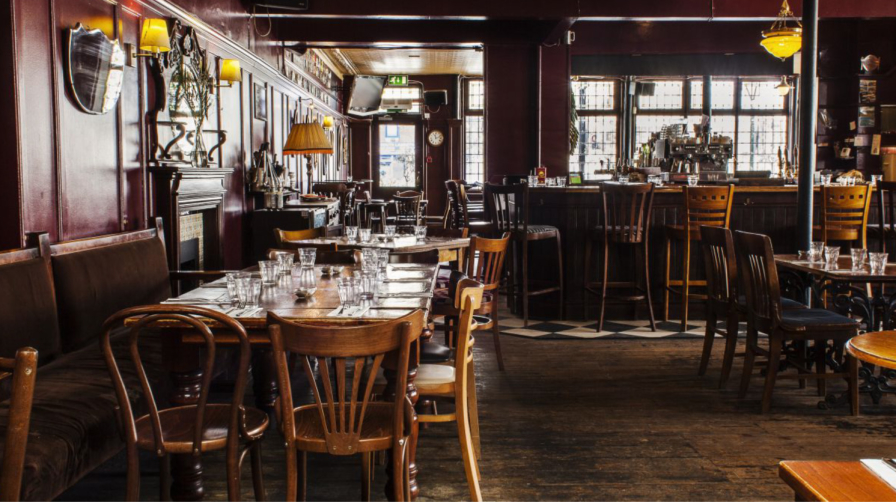Interior view of chairs and tables Canton Arms