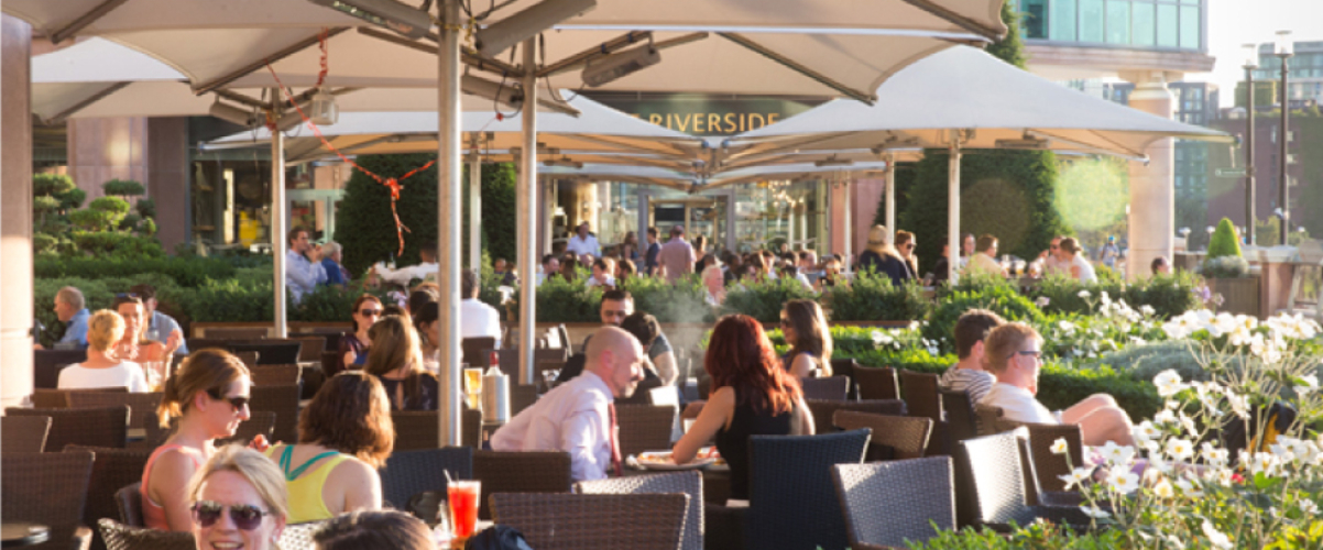 Outside diners sat in Sun at Riverside Vauxhall