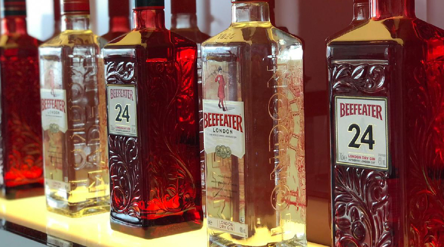 Close up of multiple beefeater gin bottles in a row