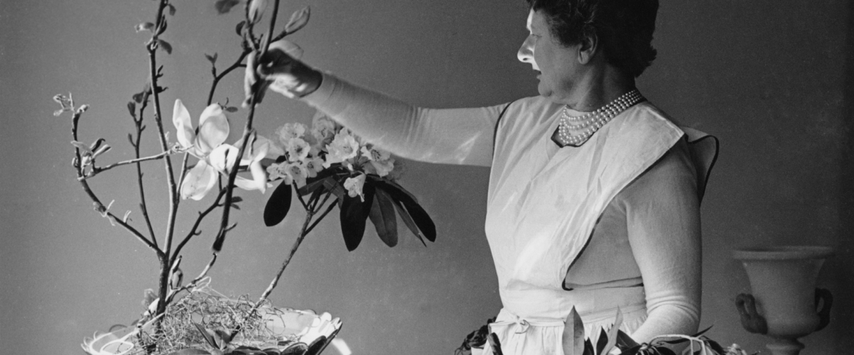 Black and white image of Constance Spry arranging flowers